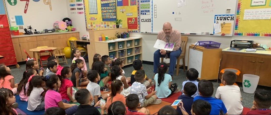 Mr. Baker reading to Kinder
